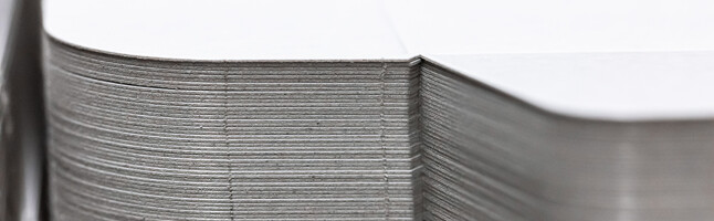 Stack of die-cut blanks with nicks | © Marbach Group